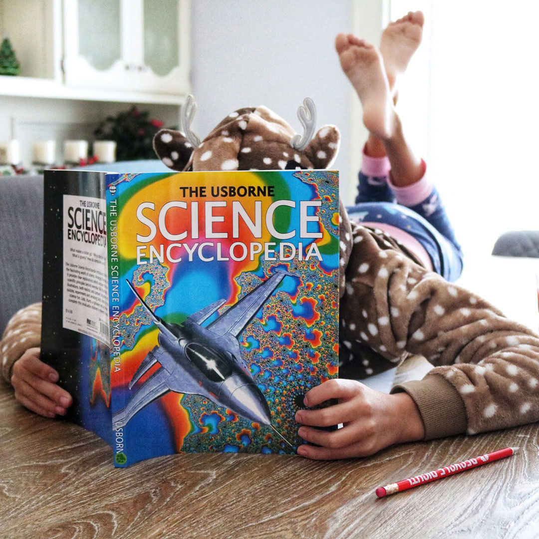 Girl reading her Science curriculum
